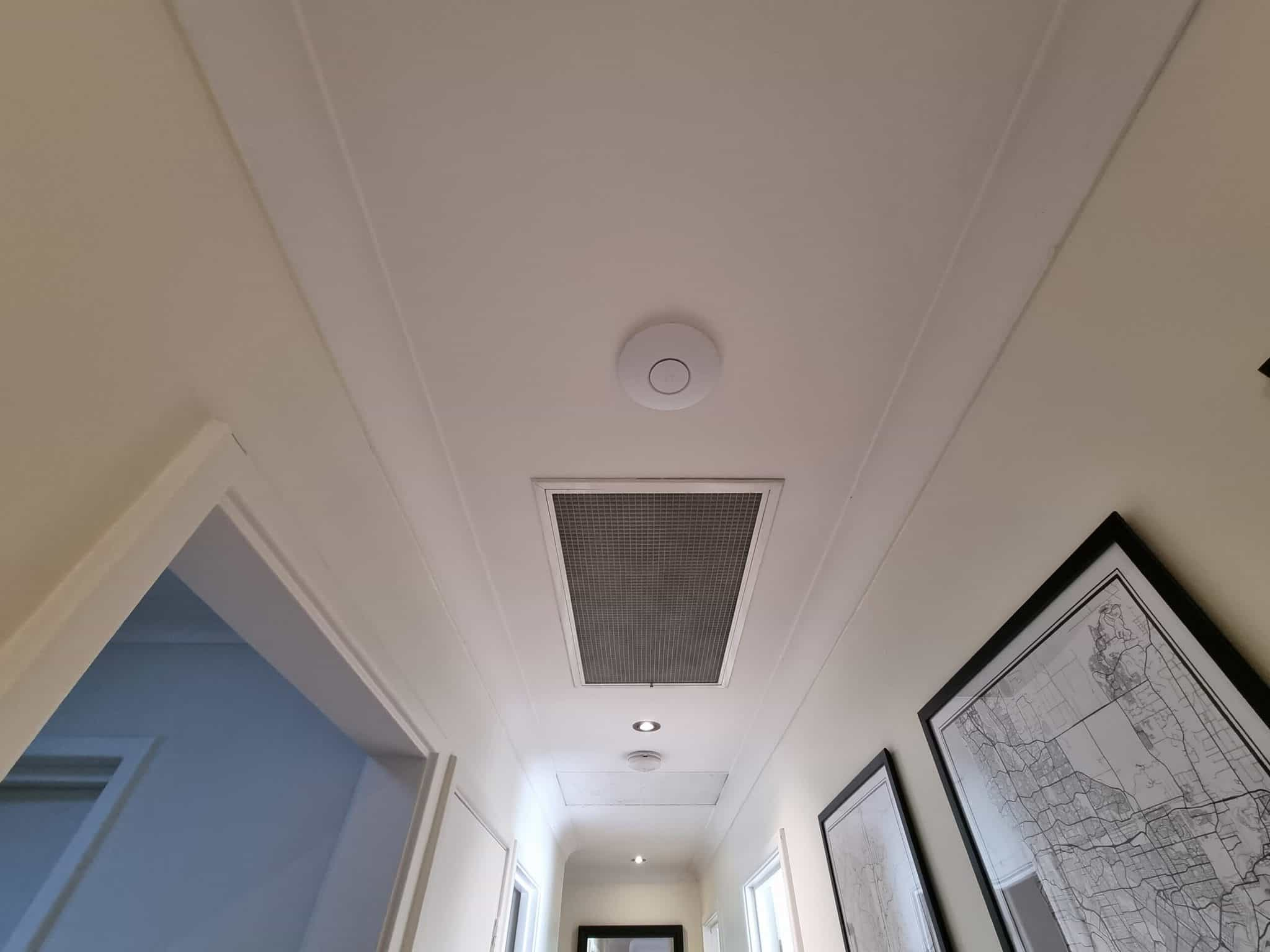 Installation of Ubiquity in a hallway to provide fast intenet to the whole hosue
